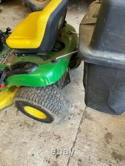 John Deere little used 110. 42 cut ride on mower. New last season