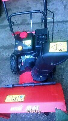 Petrol snow blower / thrower two stage pedestrian self propelled standby machine